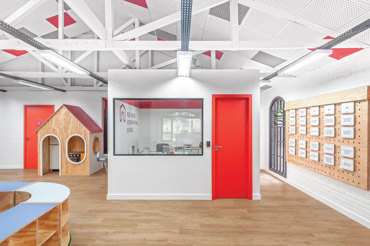 A pop of color enlivens this indoor house within the school.