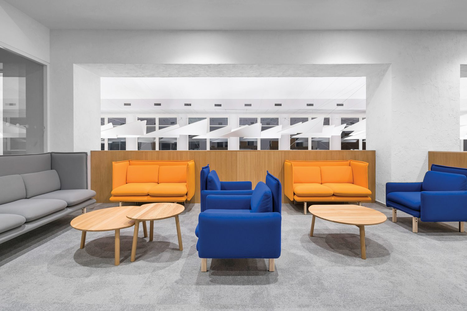 Yellow and blue seating in a lounge area.