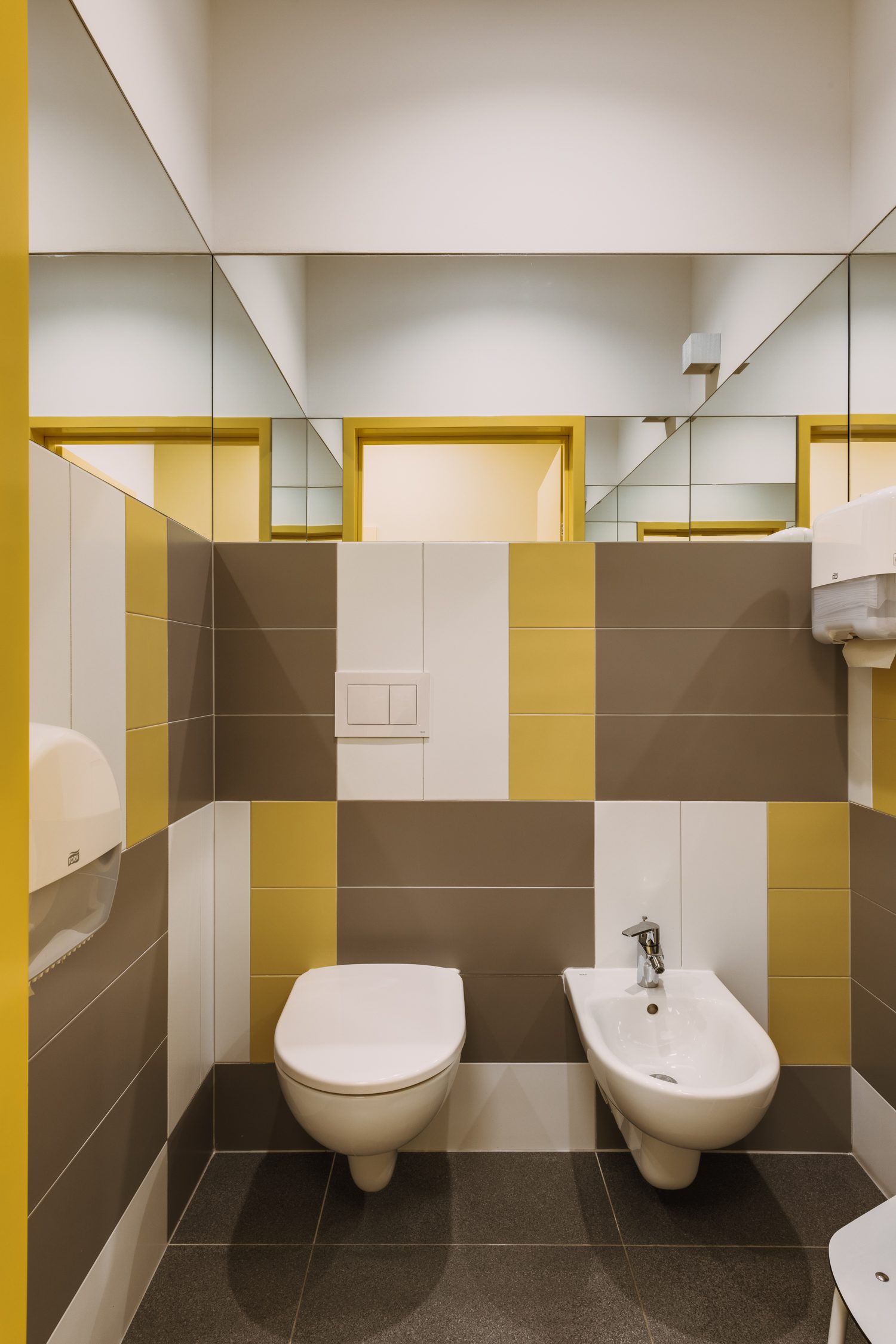 Wall and floor tiles in the bathrooms reiterate the gold-tone color palette.