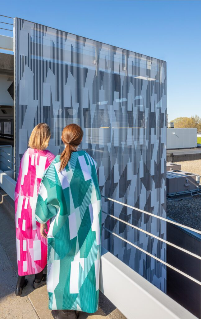 Kendall Square Garage, with graphic facade and dresses by French 2D. Photography © John Horner