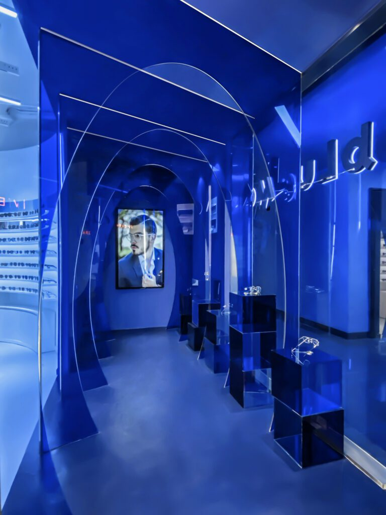 Blue acrylic panels matched to Pantone 2728 define the store's entry.
