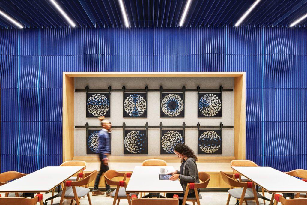 A cobalt blue wall serves as a frame fir an art installation in the cafe.