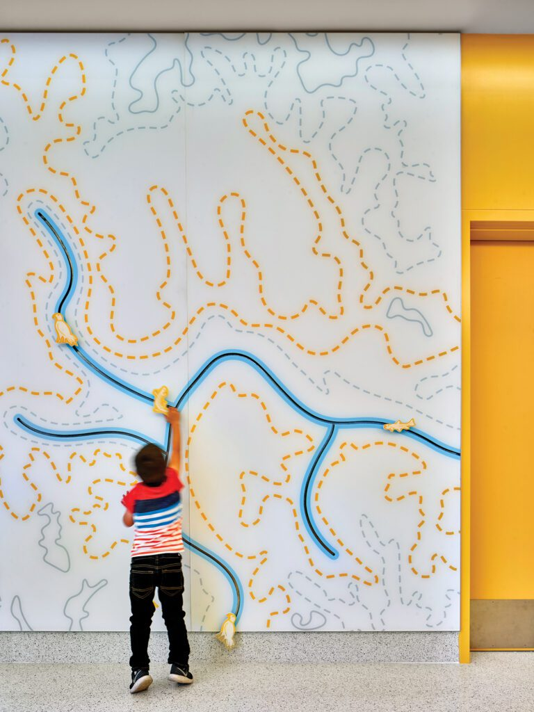 mural with yellow and blue lines.