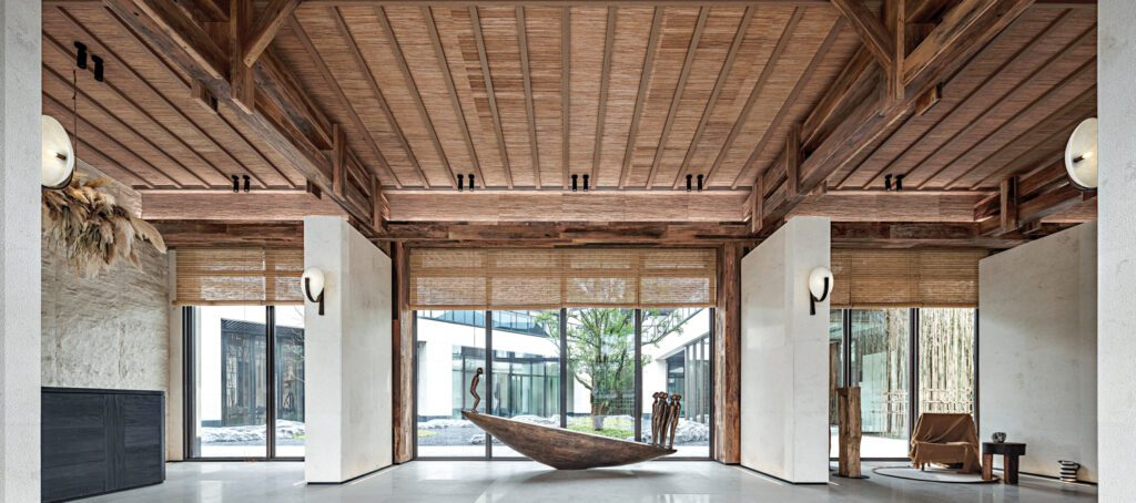 The ceiling features slender planks of timber for a meditative aesthetic.