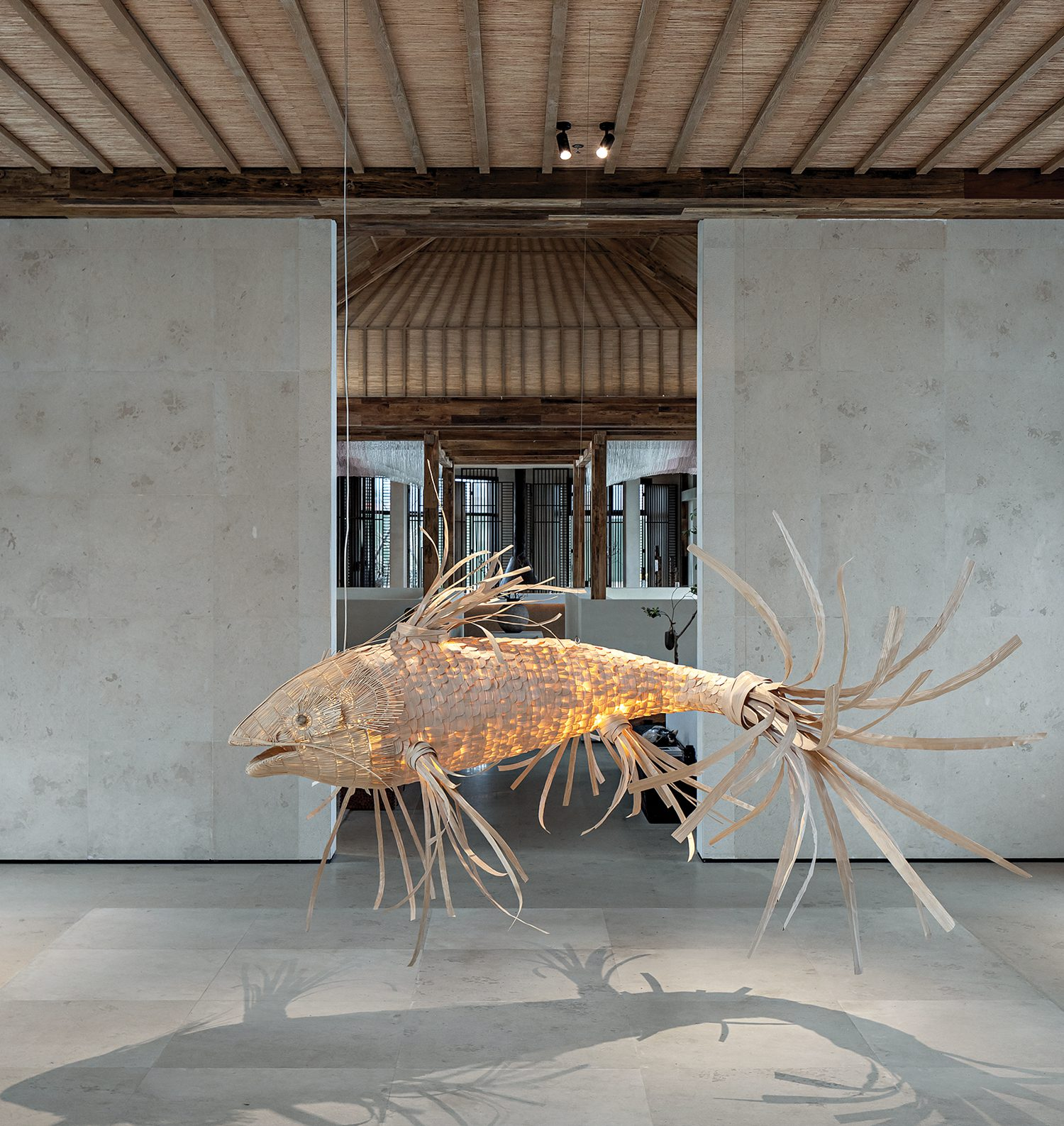 An immense floating fish, commissioned for the project and crafted of woven bamboo, nods to the idea while also being an auspicious omen in Chinese culture.