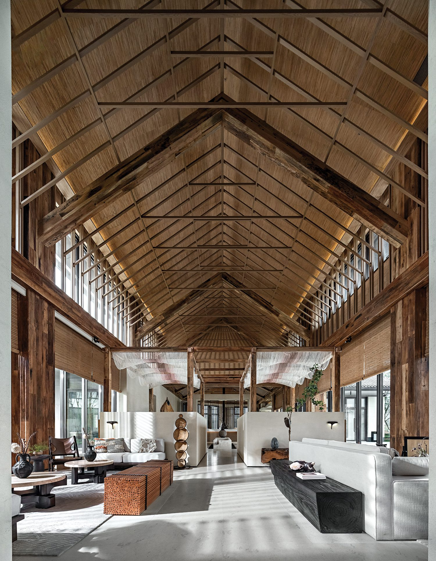 A pitched ceiling offers a rustic quality to the gallerylike interiors.
