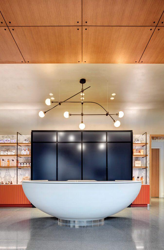 A modern light fixture illuminates a sitting area.