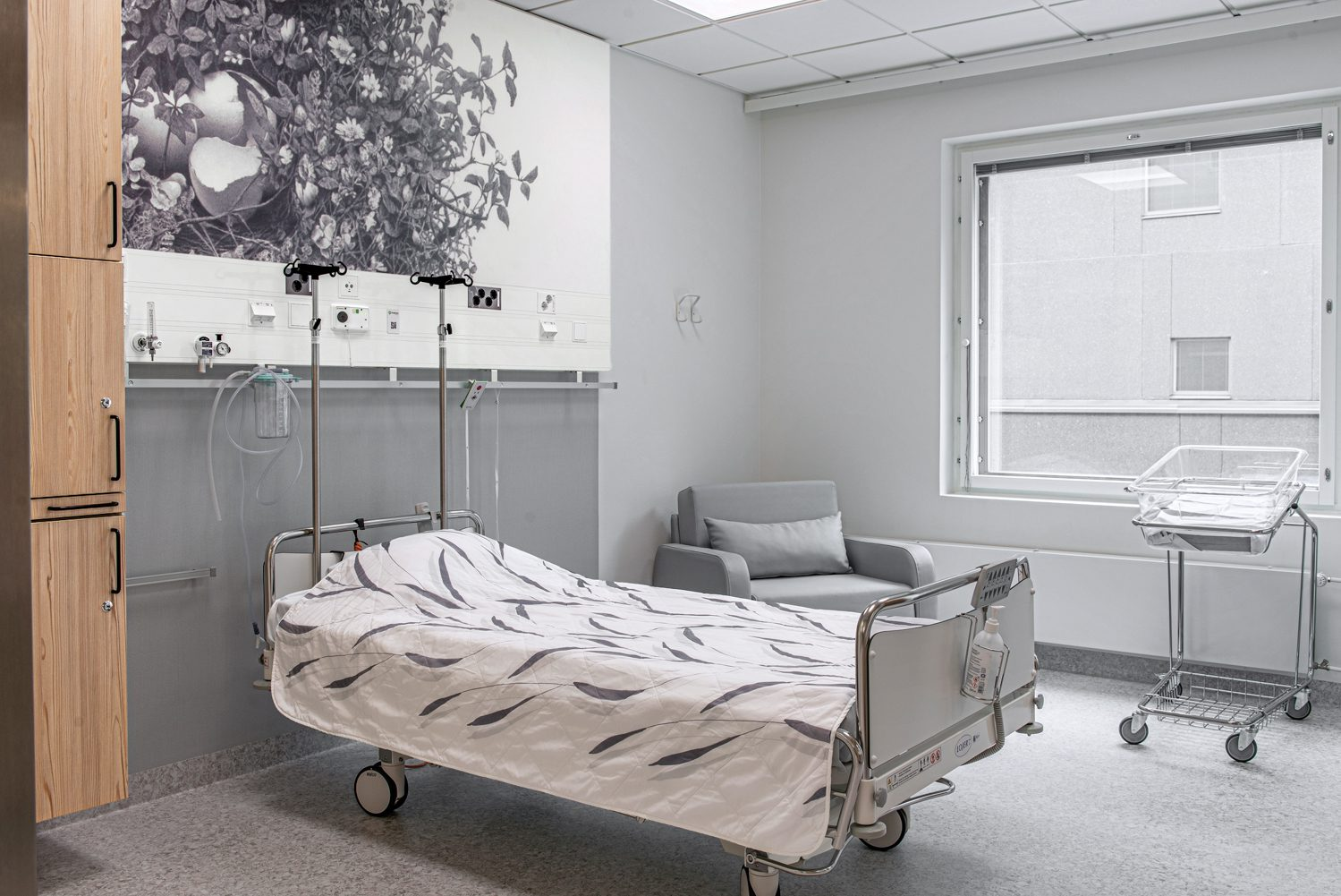 Yuichiro Sato's pencil and coal drawing of a bird's nest is printed on awall's laminated board in one of the 368 patient rooms. Photography by Pauliina Salonen.