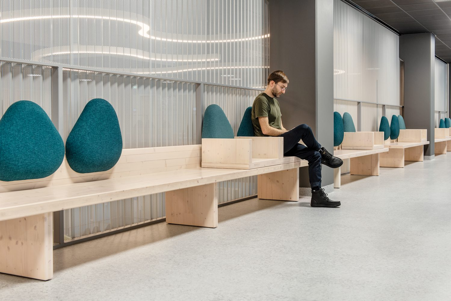 The atrium's custom cross-laminated timber benches—ranging from 5 to 14 feet long—have moveable polyester cushions that can be leaned against or sat on. Photography: Pauliina Salonen.