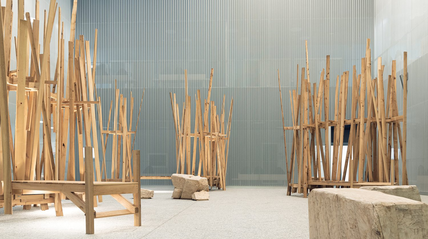 In a courtyard off the atrium, Tapper's aspen and alder sculptures provide seating; photography: Hannu Rytky.