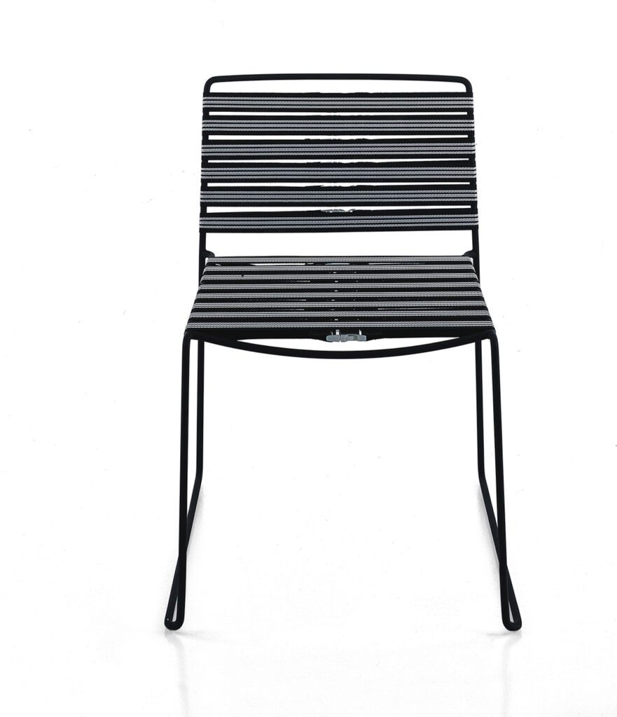 A black spindle chair from the Material House collection.