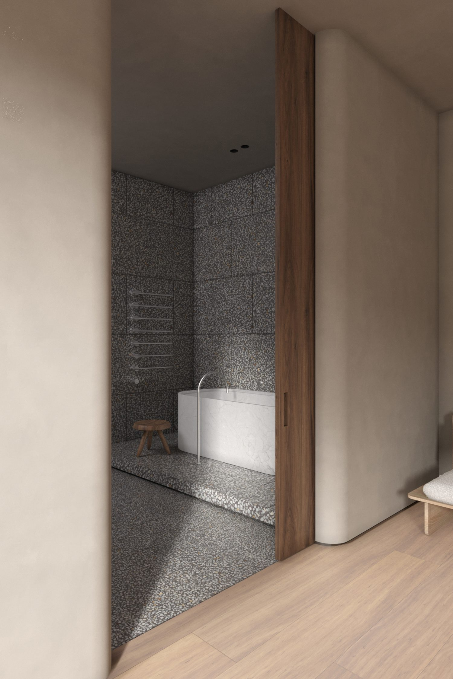 Piet Boon's mixers for Cocoon activate a custom marble tub in a bathroom.