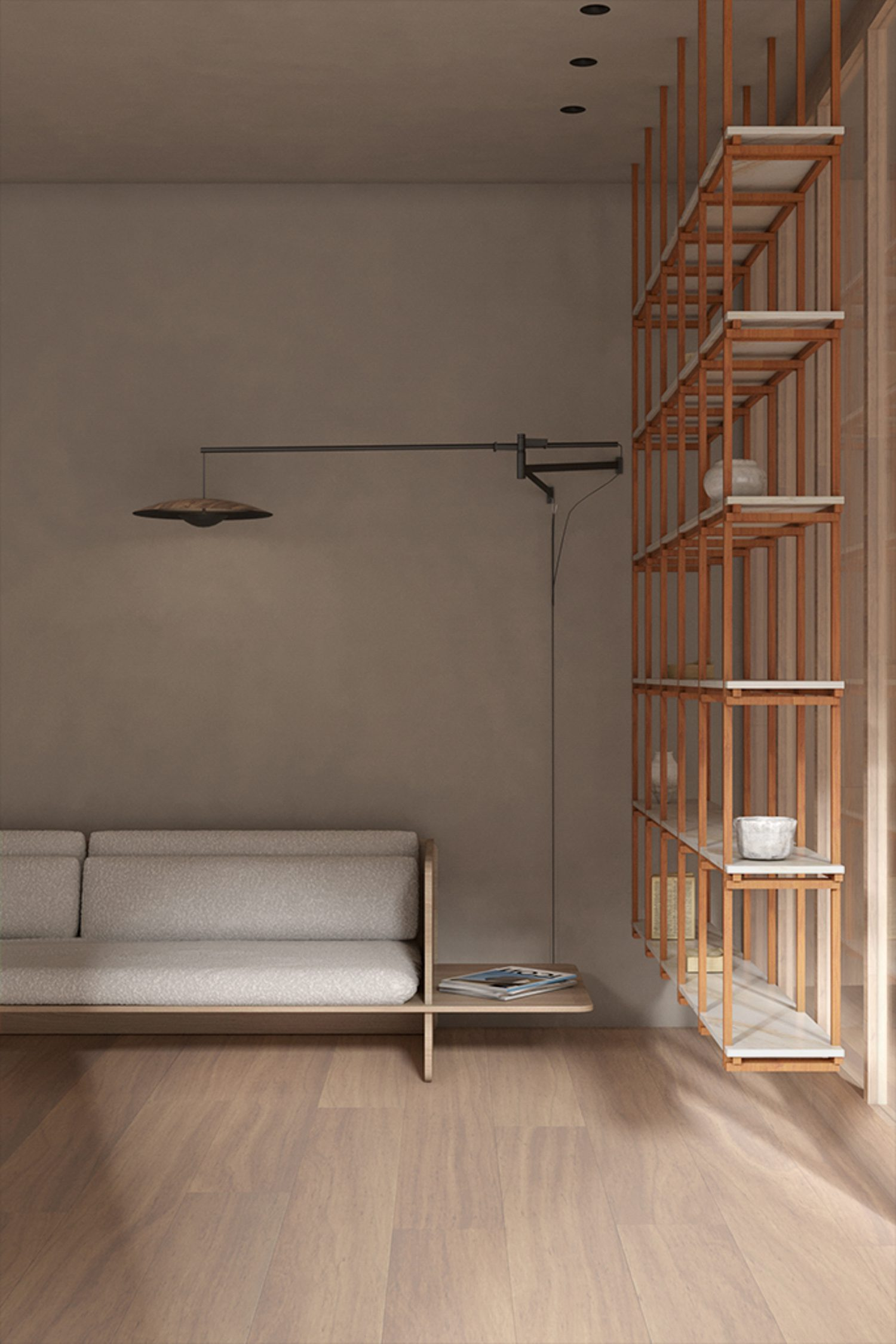 A Marset floor lamp shines upon a sofa by Space Copenhagen for Benchmark.