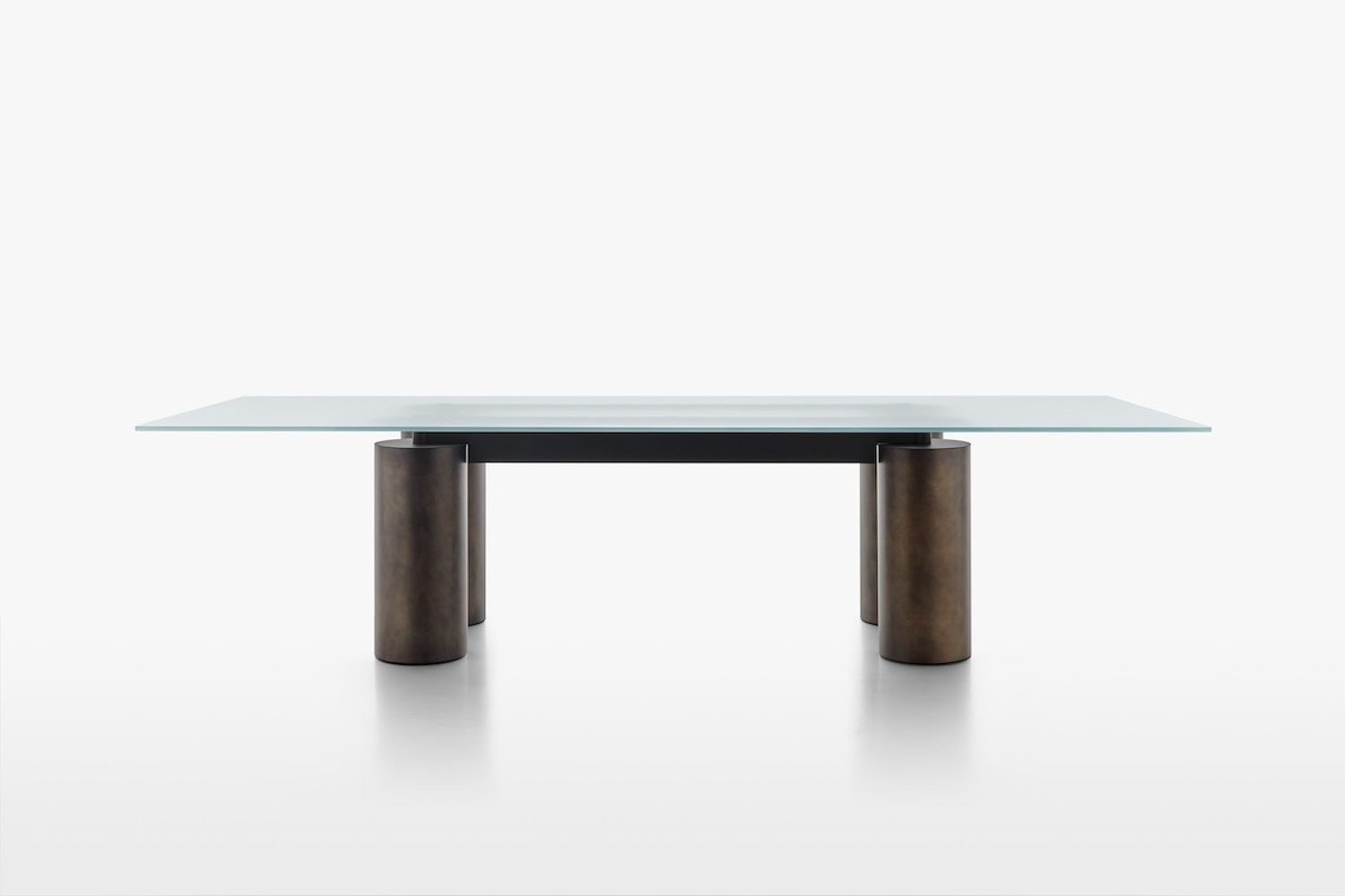 A plane of glass rests on four tubular columns and stretches nearly 10 feet – this striking composition, offered in various states of transparency, defines the Serenissimo table, designed by Lella and Massimo Vignelli and David Law in 1985.