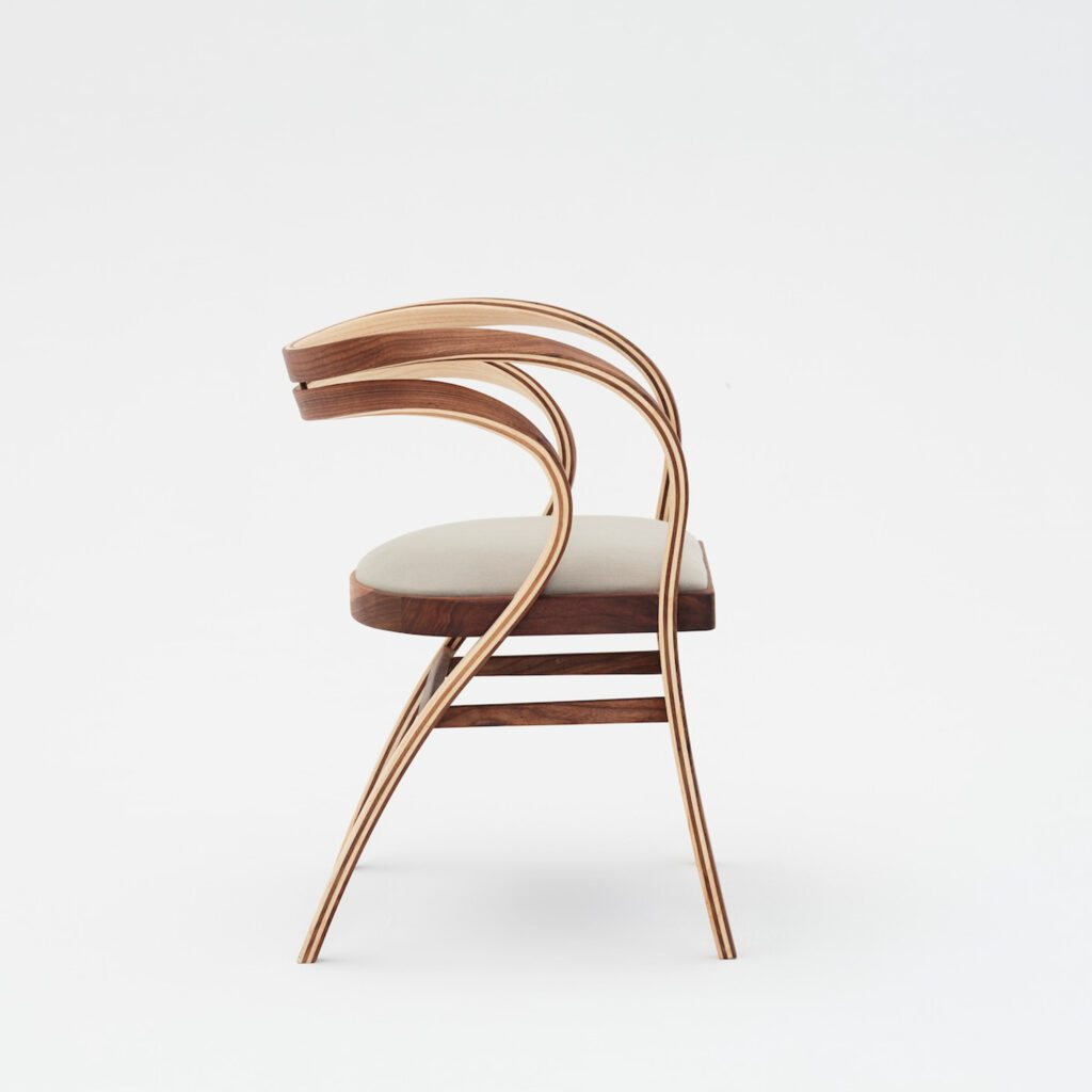 Sinuous handcrafted chair with an airy frame.