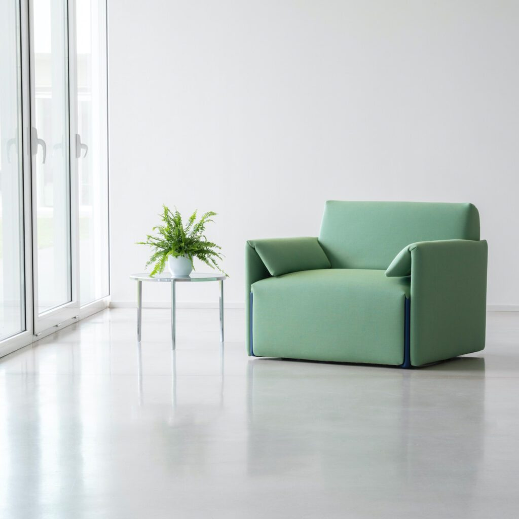Armchair in a soft green hue.