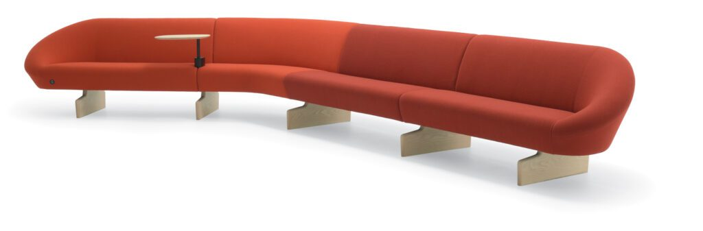 A large red couch with a curved back.