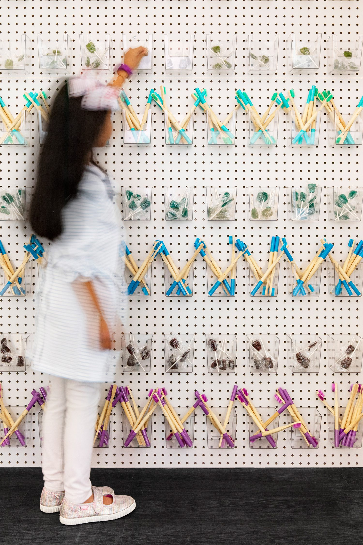 A pegboard wall offers treats for the patients.