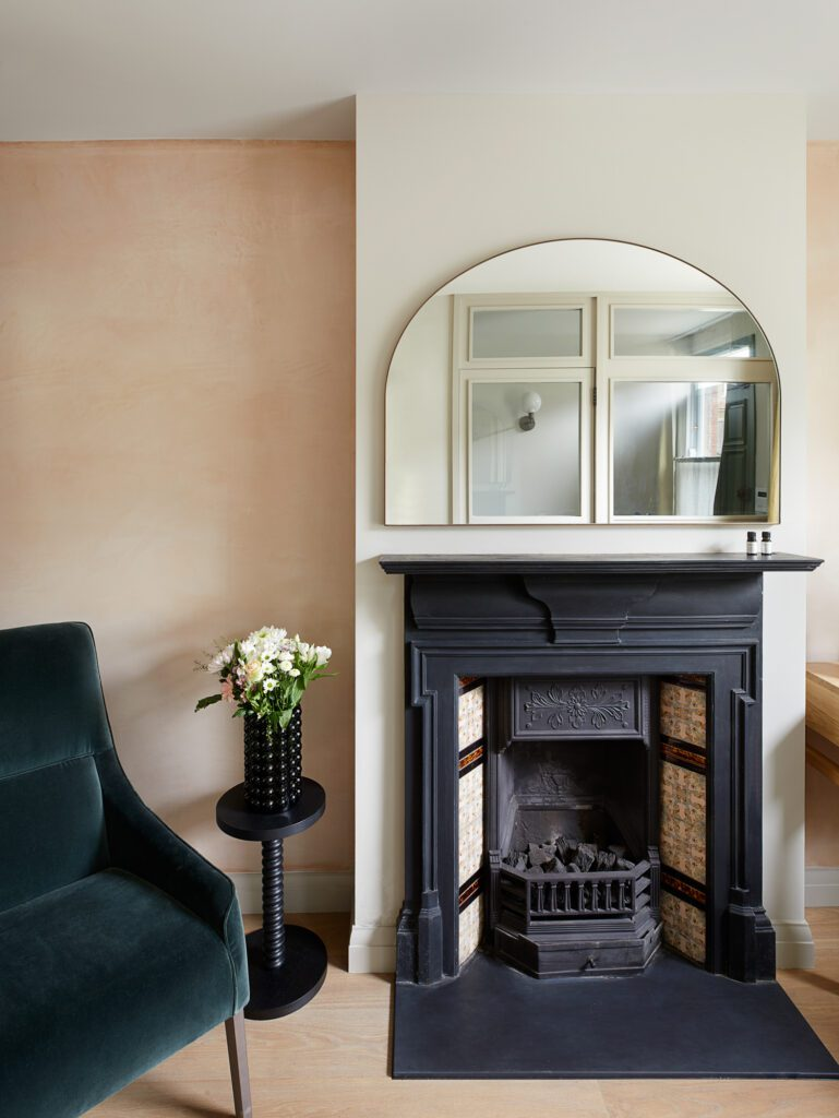 Near the front of the house, the entrance study area houses the retained Victorian fireplace.