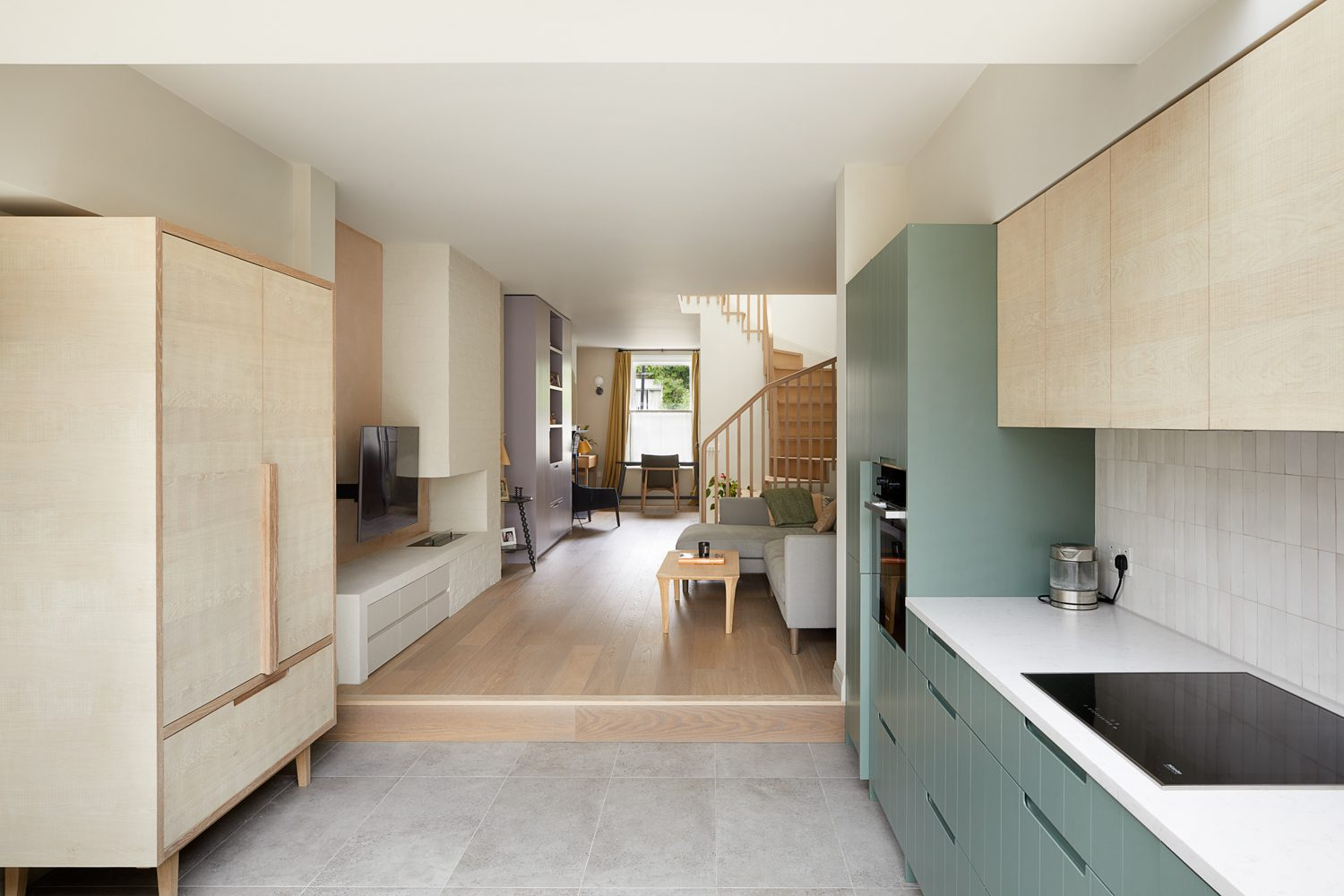 Built-in furniture on both floors makes clever use of space, complementing the open layout and providing ample storage.