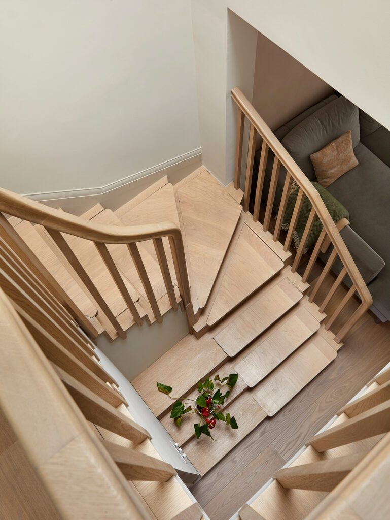 The team reconfigured the stairs, creating a triple height stairwell that serves as a focal point in the home.