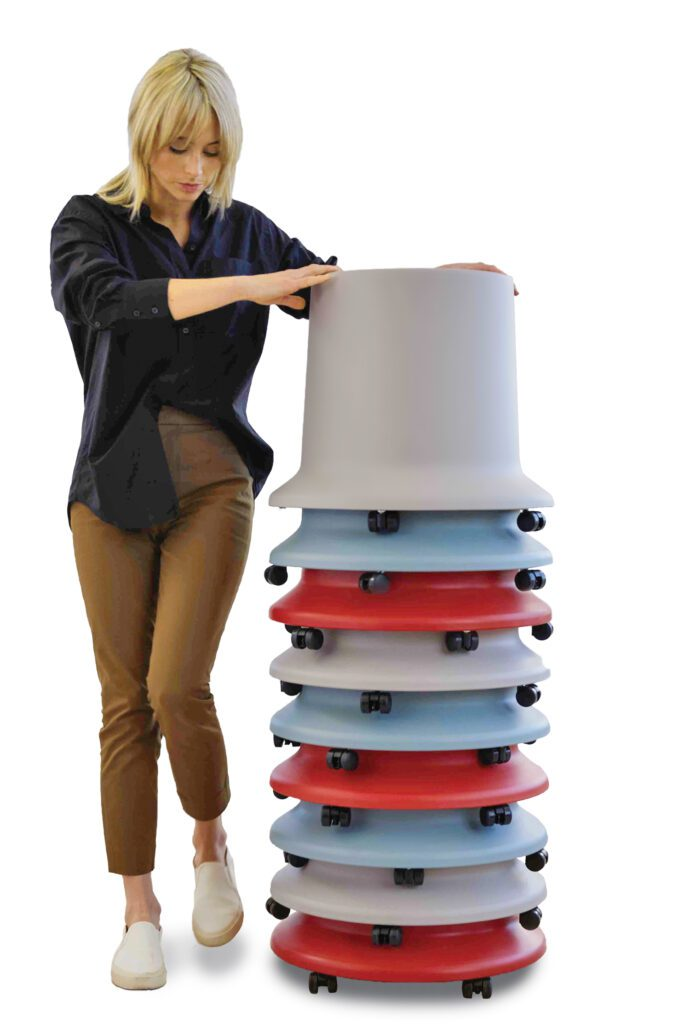 The stackable stool, pictured here in light blue, gray and redinspired by buckets, is on casters and is mobile. Here, a woman pushes a tower of the stacked stools.
