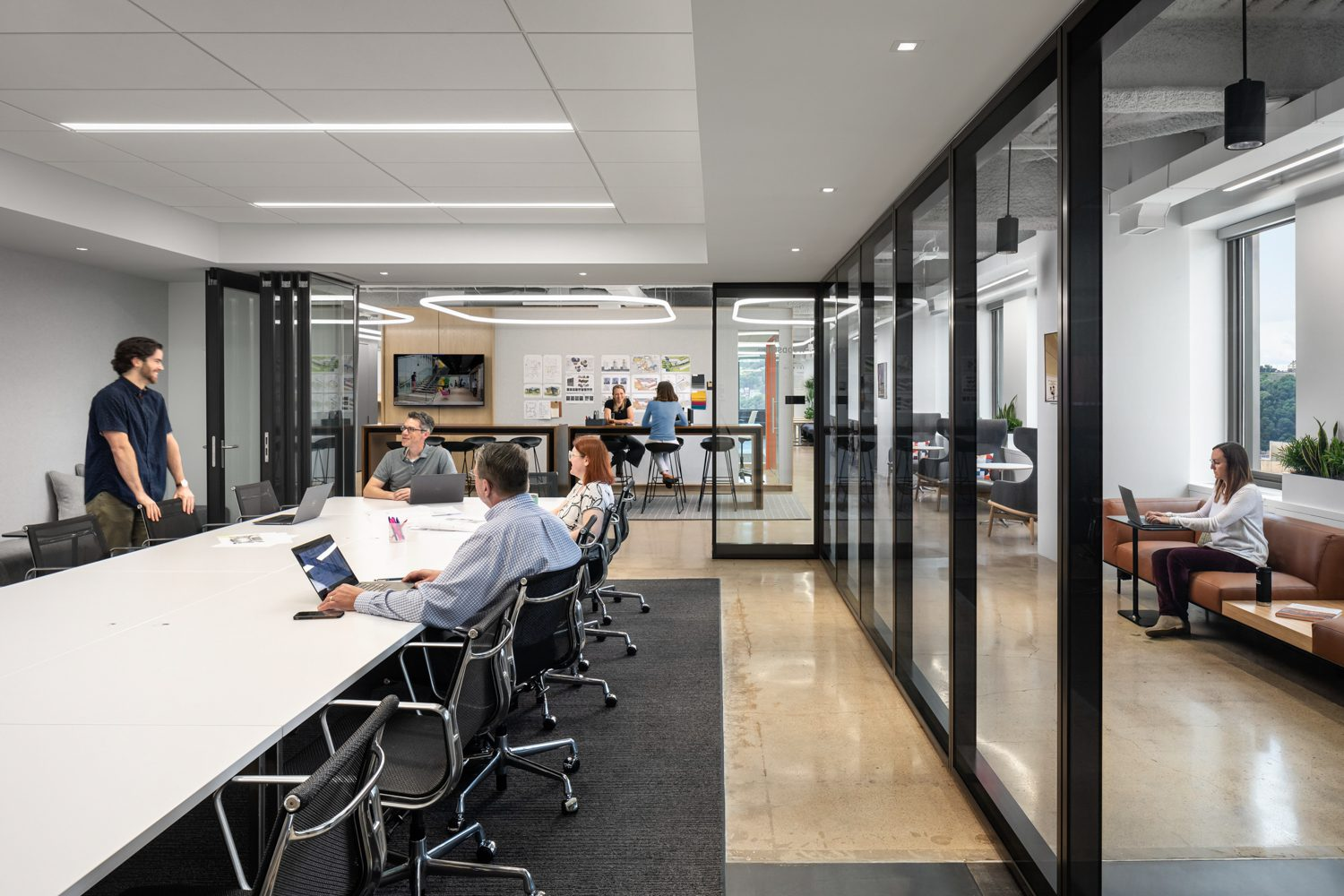 A Muraflex interior storefront defines the conference room, with Herman Miller seating and a table by Coalesse.