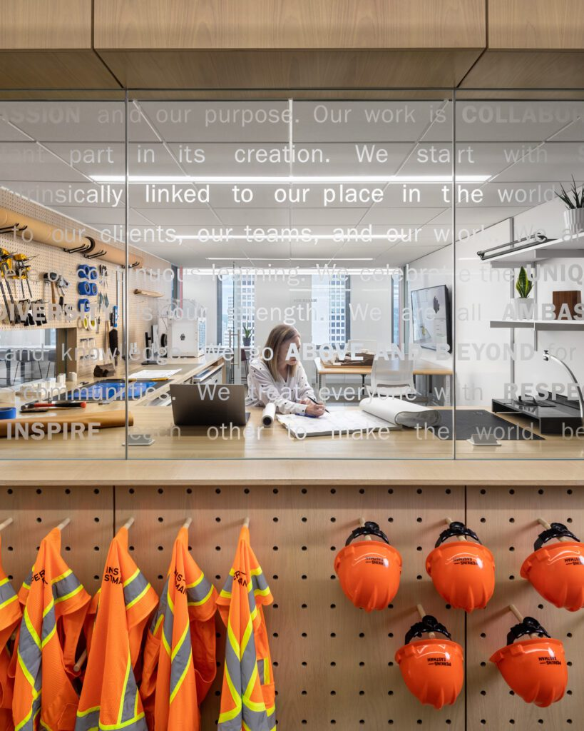 One wall of the maker box comprises glazing and a pegboard for hard hats and construction vests.