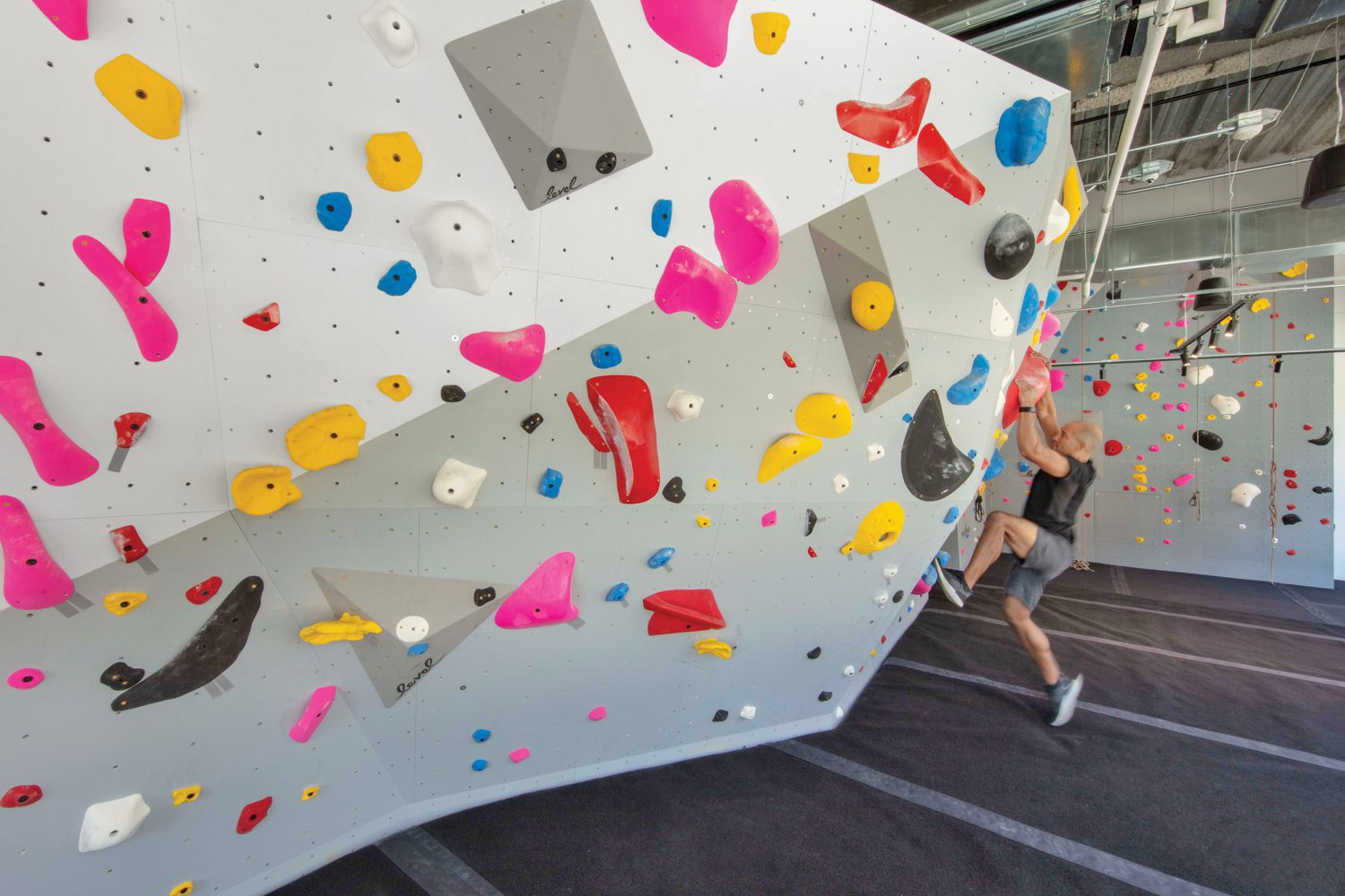 In the fitness center at the VF Corporation headquarters in Denver, Rapt Studio installed a 26-foot-tall climbing wall.