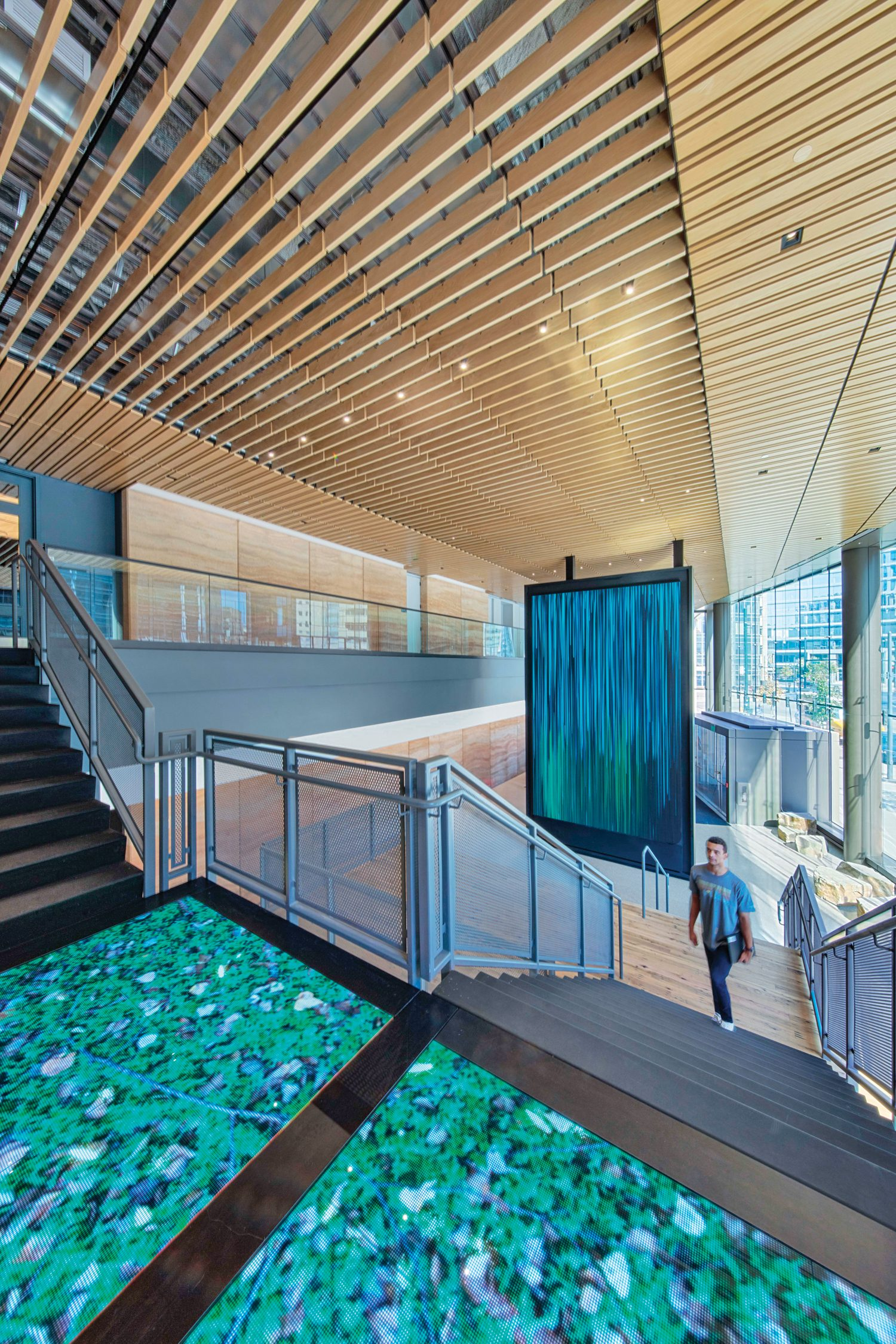 The lobby's 12-by-20-foot LED screen and boulder seating channel VF's focus on technology and the outdoors.