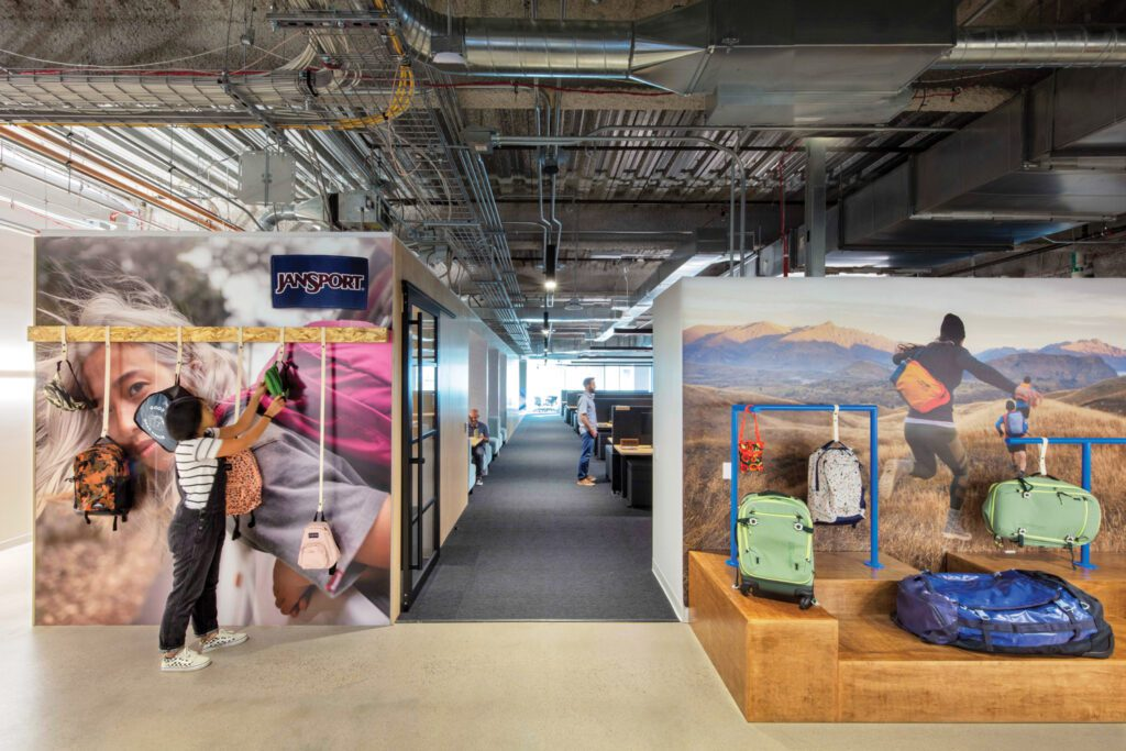 In the JanSport office, printed vinyl wallcovering depicts brand marketing images.