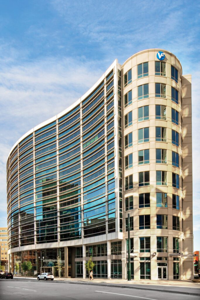 The headquarters occupies a 10-story building completed in 2002 by Klipp Colussy Jenks DuBois Architects.