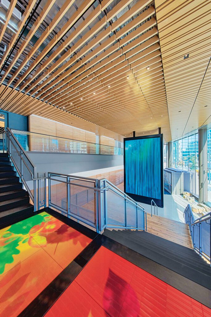 Interactive LED floor panels on the lobby stair landing.