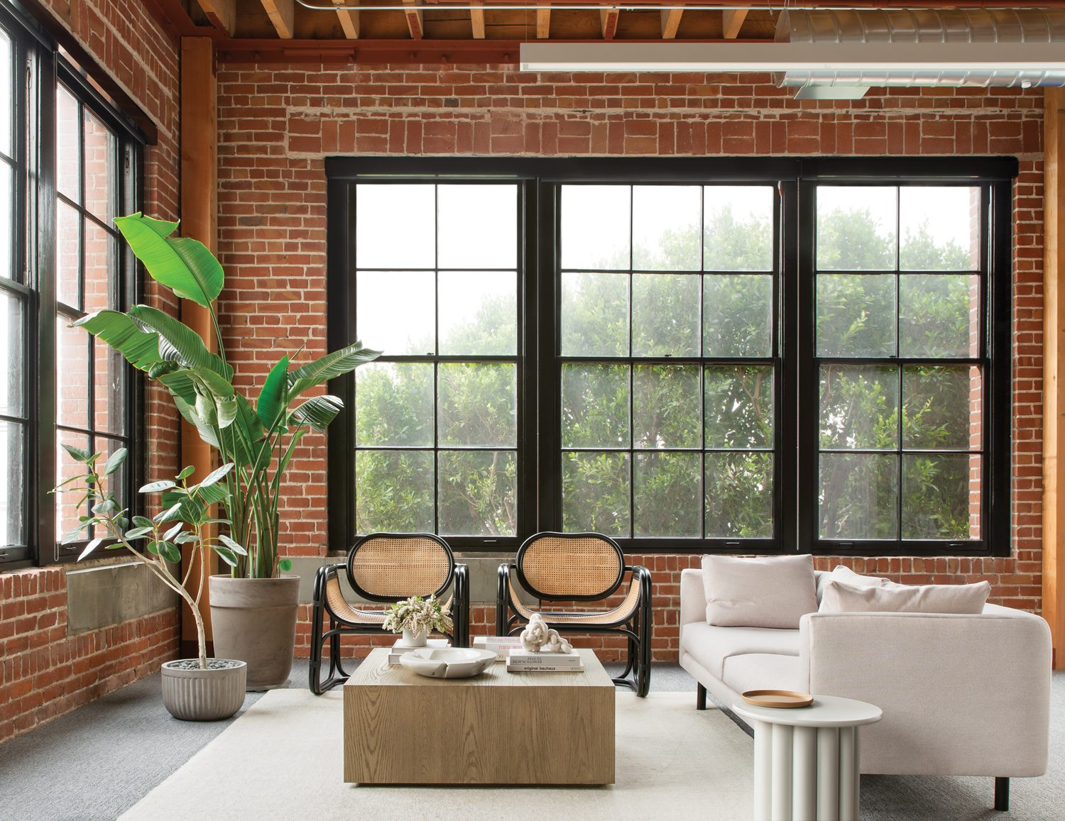 A corner lounge shows off the 1910 former warehouse's extensive windows, their wood frames repainted, and offers alternative work space.