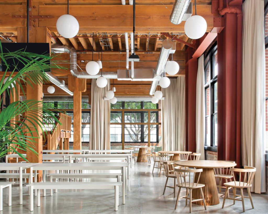 The Douglas fir columns and stair in the commissary/all-hands are original, but the existing concrete floor has been newly sealed.