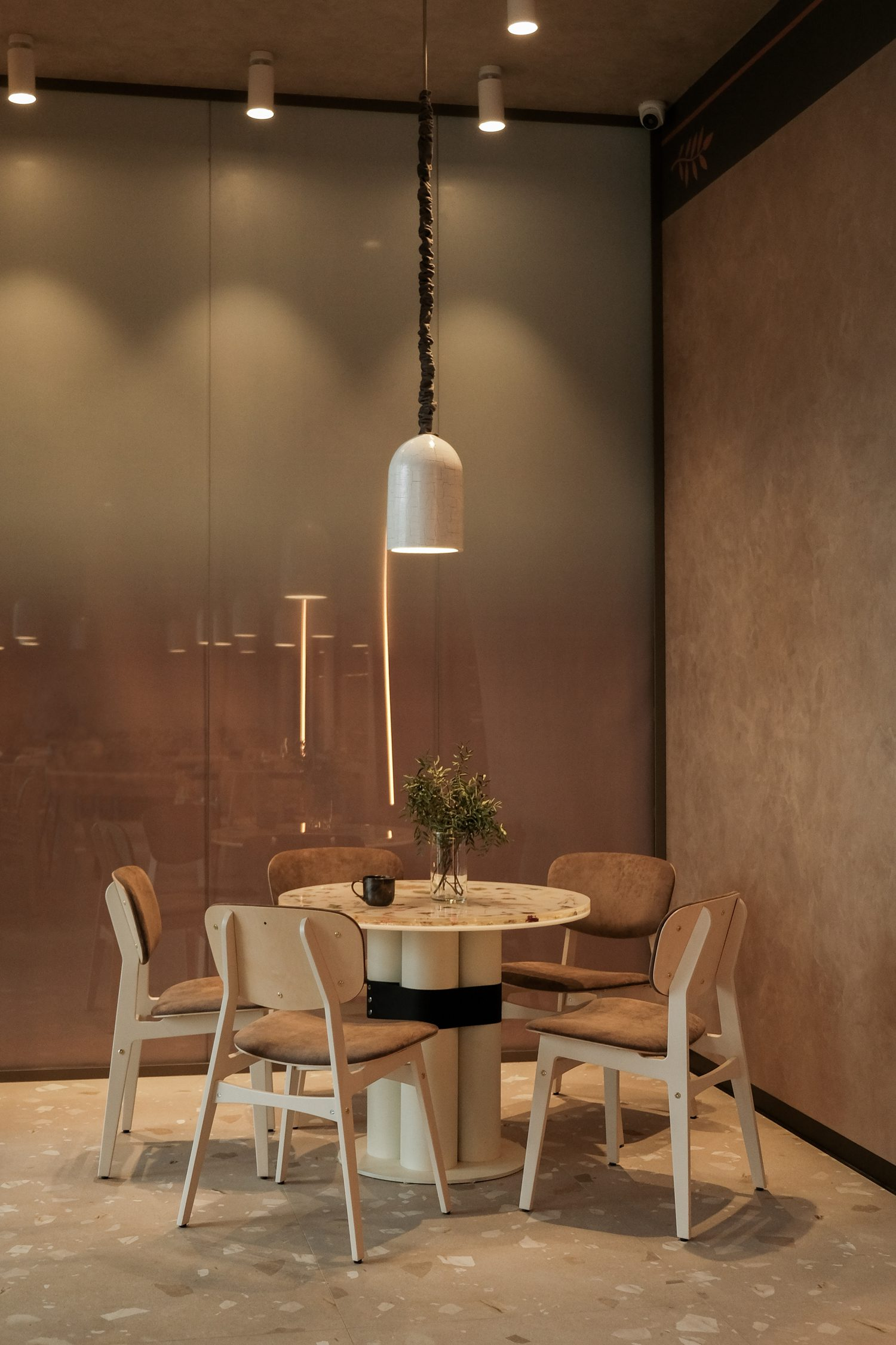 At the entrance, baguettes in a paper bag inspired the shape of the custom table's base.