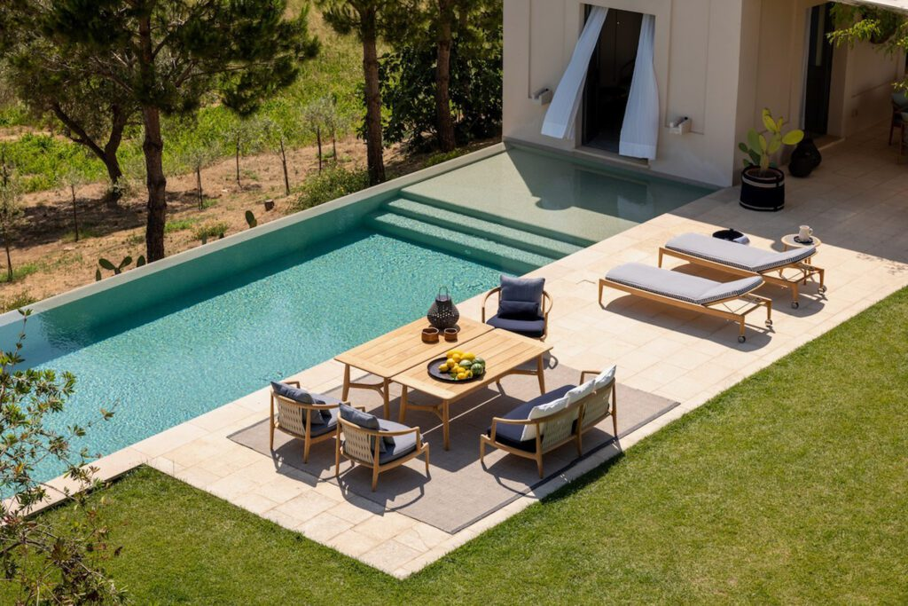 Outdoor furnishings including lounge chairs by Poltrona Frau.