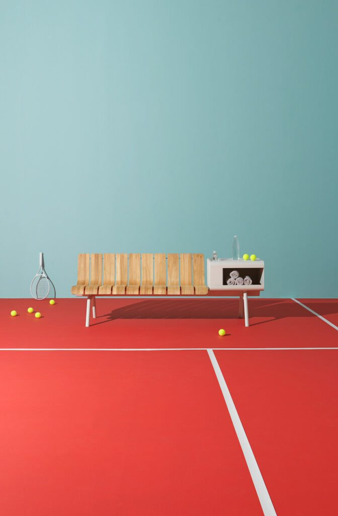 An aesthetic home run for tennis courts, pools, athletic clubs, and resorts, Ace is offered in four hues including warm white (shown) and moss green.