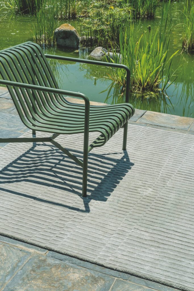 Hand-tufted outdoor chair.