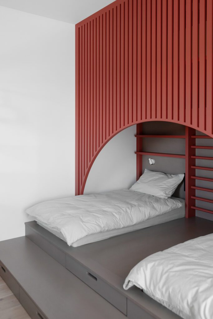The children's room features a playful canopy installation.