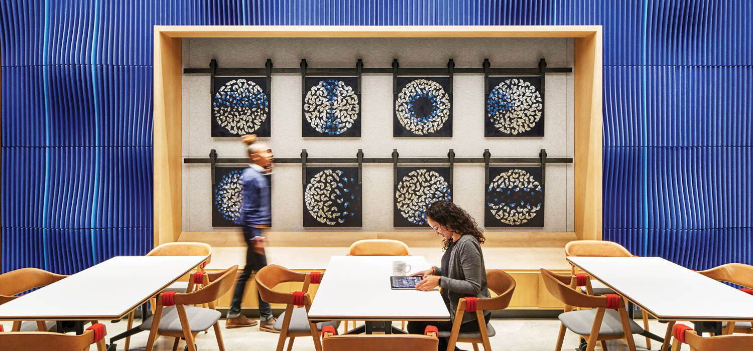 Blue walls frame an art installation in the cafe.