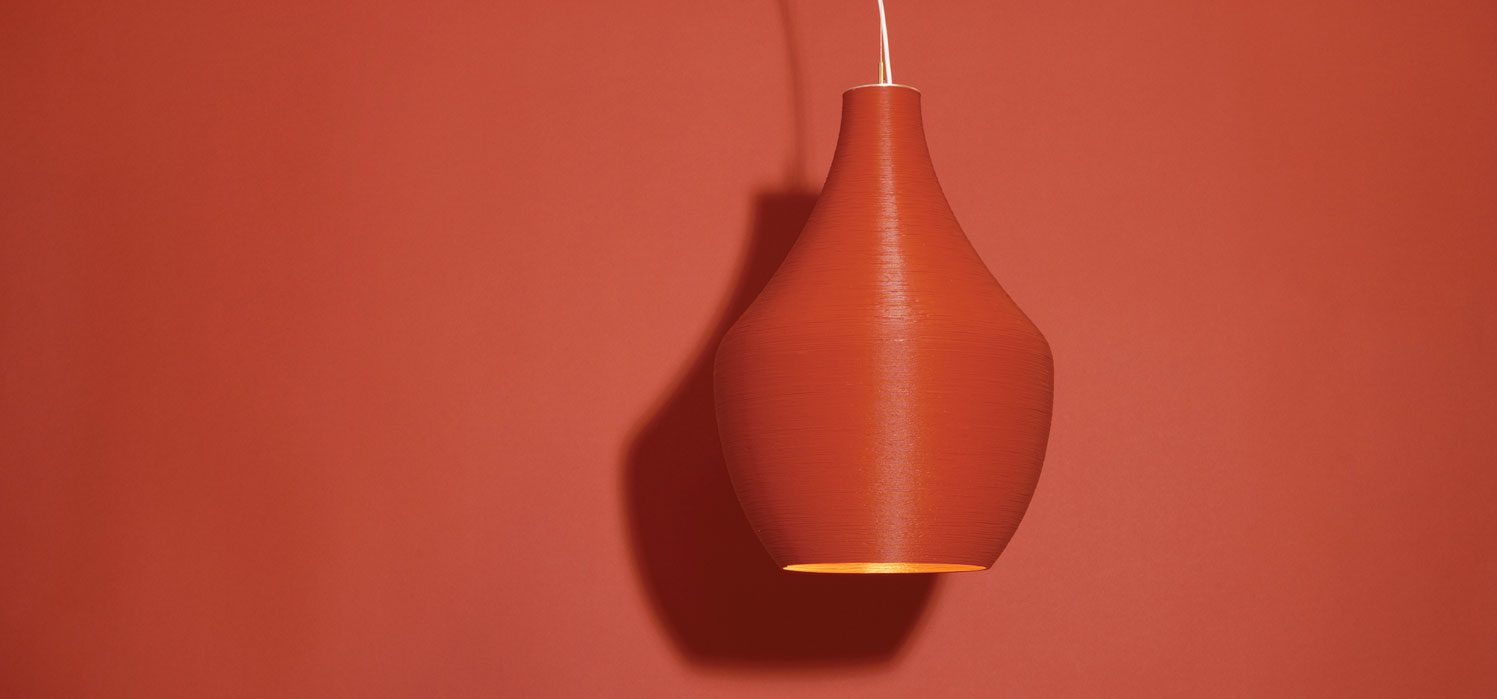 Red lamp against a red background.