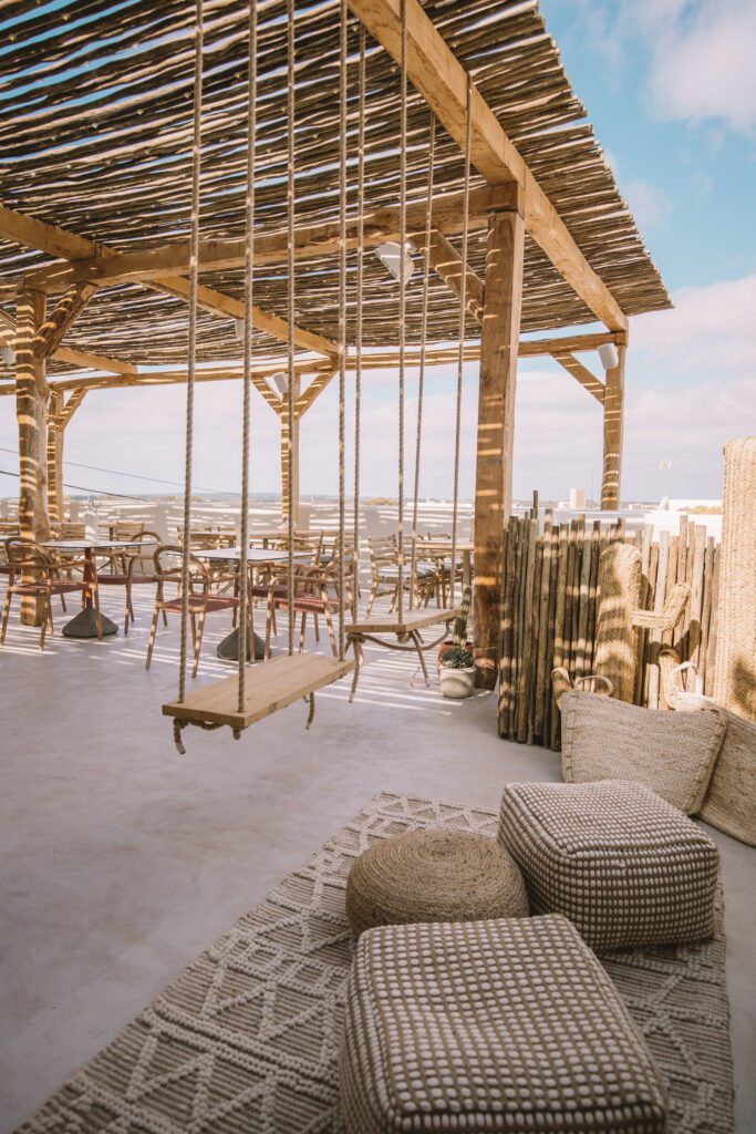 The second-floor pergola offers swings, and enviable views of the island.