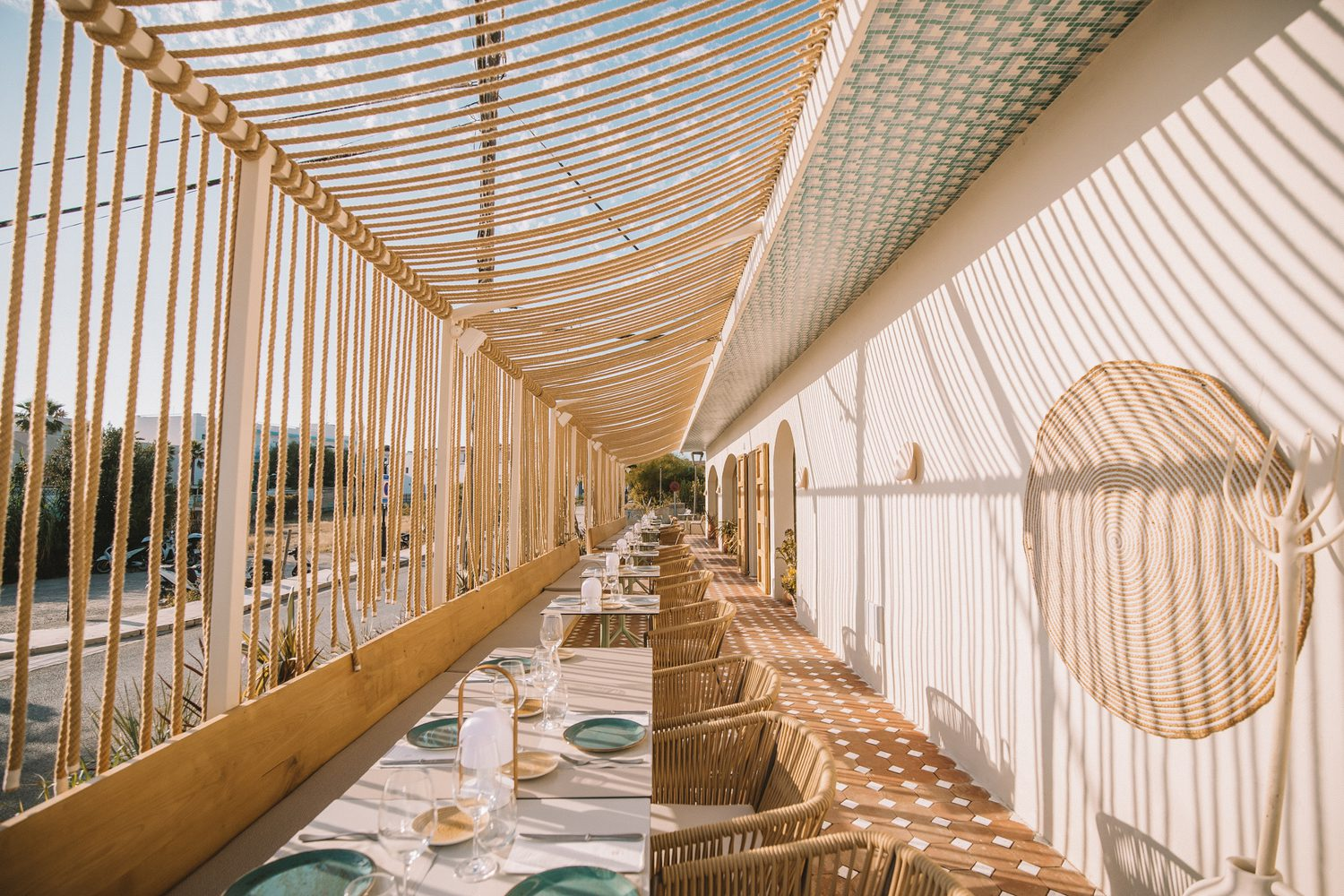 An outdoor terrace juxtaposes rope shadows with graphic patterns of tiles.