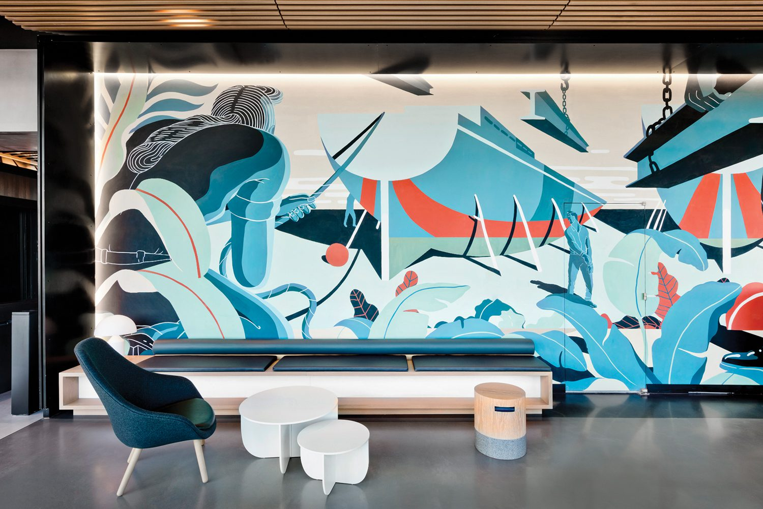 Bryce Wymer's mural anchors another lobby vignette.