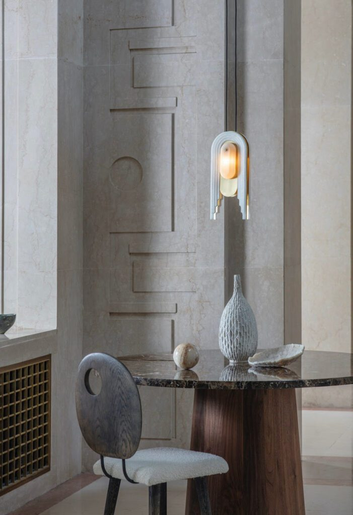 The collection consists of two pendant lights, a wall light, and floor and table lamps.