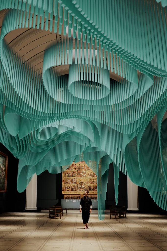 A digital visualization of teal forms hanging from the ceiling.