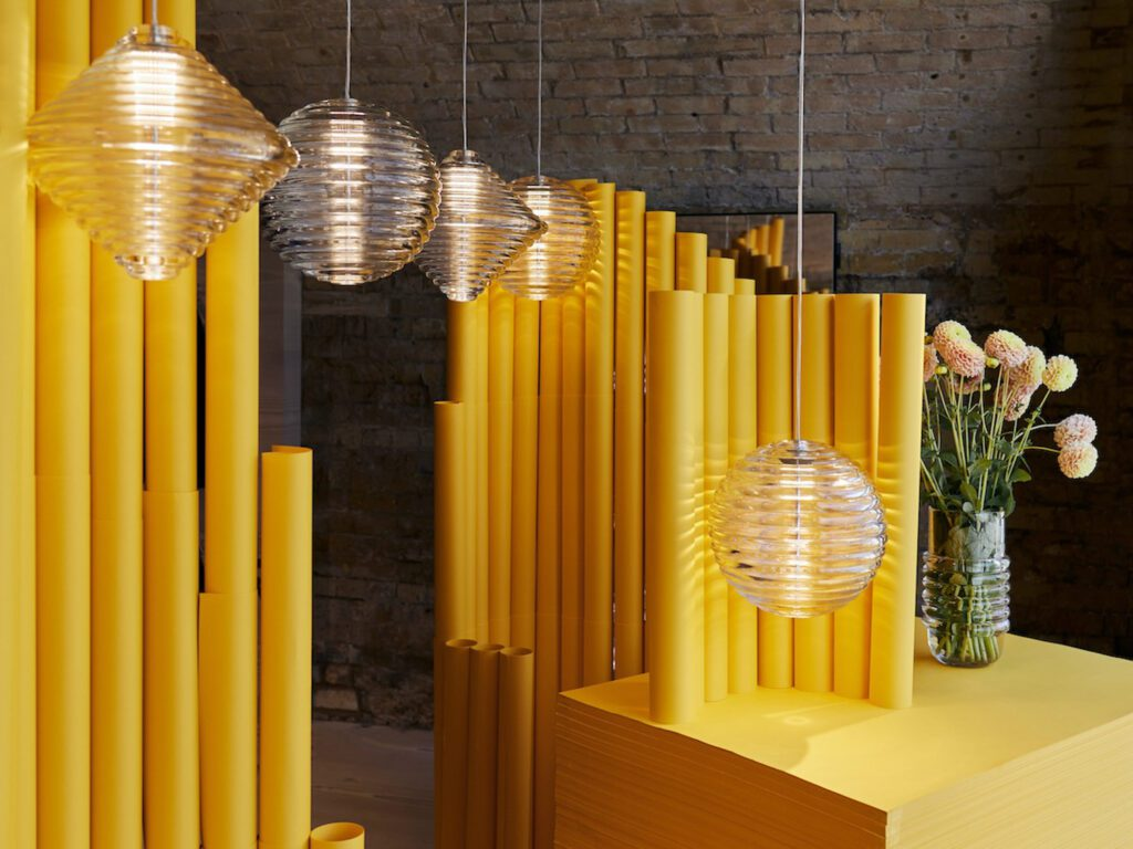 Thick ribbed glass embodies the geometric shapes of the Press light by Tom Dixon.