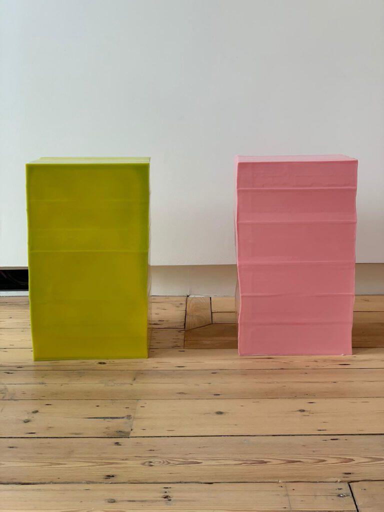 Green and pink block stools.