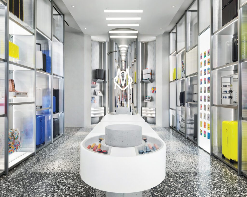 The Rimowa luggage store in SoHo, a collaboration between MA-MA and Mass Studio, includes a new passport-photo booth enclosed in a mirror-polished stainless-steel column at the end of a 12½-foot-long custom display table.